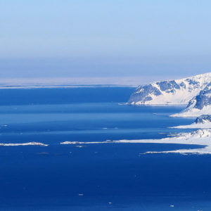 Blu sea, white mountains and the ice shelf line at the horizon North Spitsbergen peaks, no body, no tracks, no names @ Massimo Candolini